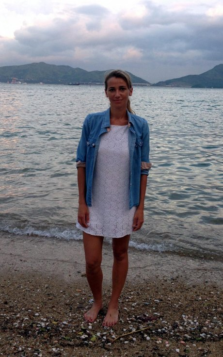 Christina Dean, founder of Hong Kong based ethical fashion NGO Redress wearing white stretch-lace dress post-repair