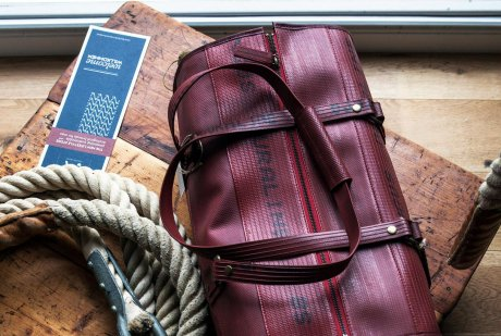 Elvis & Kresse fire hose bag on sale at Atelier Akeef, new sustainable menswear shop in Berlin Mitte