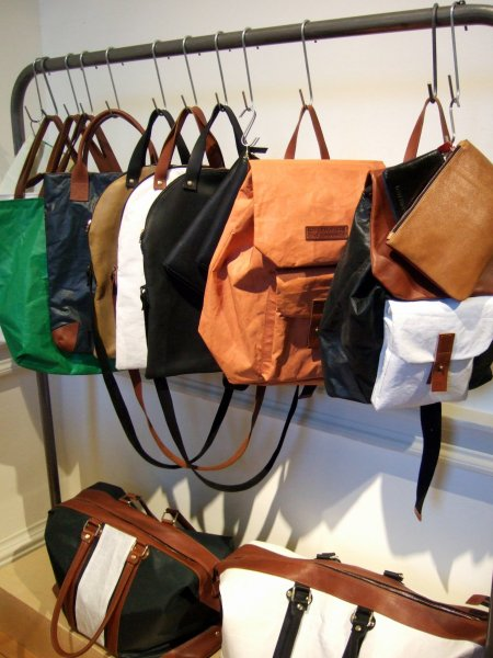 Upcycled sail cloth and veg-tanned leather bags by Lost Property of London