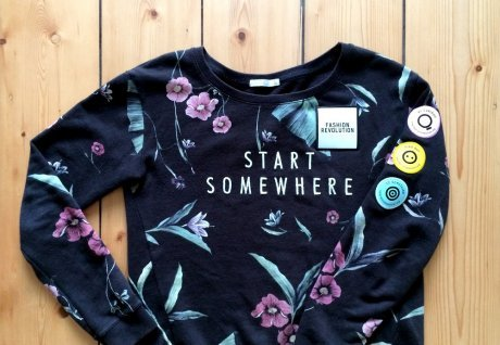 Start Somewhere sweatshirt after sewing on recycled yarn Fashion Revolution patches