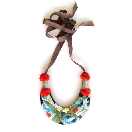 Forest necklace, hand-embroidered in organic fairtrade cotton, backed with eco-felt), super-soft pom poms and glazed handmade ceramic beads, strung on soft, vintage ribbon, £160 by A Alicia