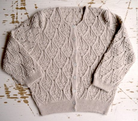 Hand-knitted wedding cardigan by Tom of Holland. Made of an alpaca, silk and cashmere blend, and vintage mother-of-pearl buttons.