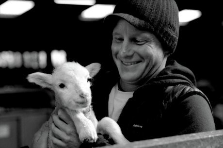 Tom Kay, founder of Finsterre with a lamb from the Bowmont flock