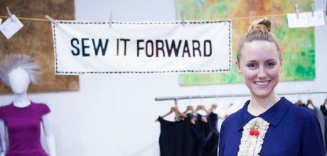 Zoe Robinson with the Sew It Forward banner