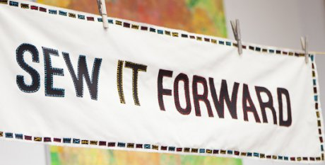 Sew It Forward banner at launch of ethical fashion website The Good Wardrobe at Henrietta Ludgate's workshop
