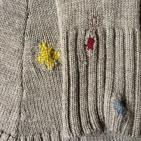 Woollen cardigan darned with wool darning yarn