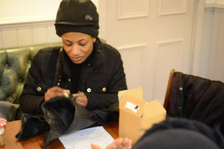 A guest re-working a leather jacket at Sew It Forward