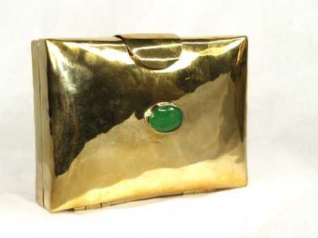 'Maxima' mini clutch made from one bomb casing with a stone setting, US$250 by Emi & Eve