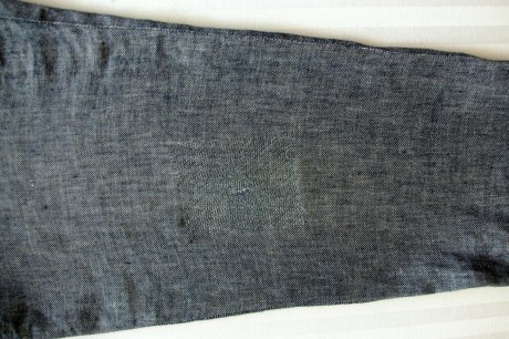 Jeans repaired with a patch