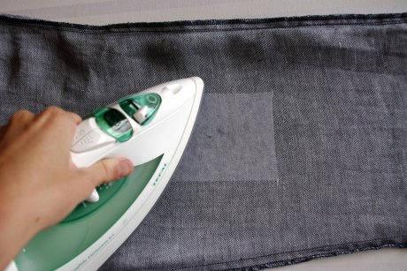 Ironing on the interfacing for the jeans repair patch
